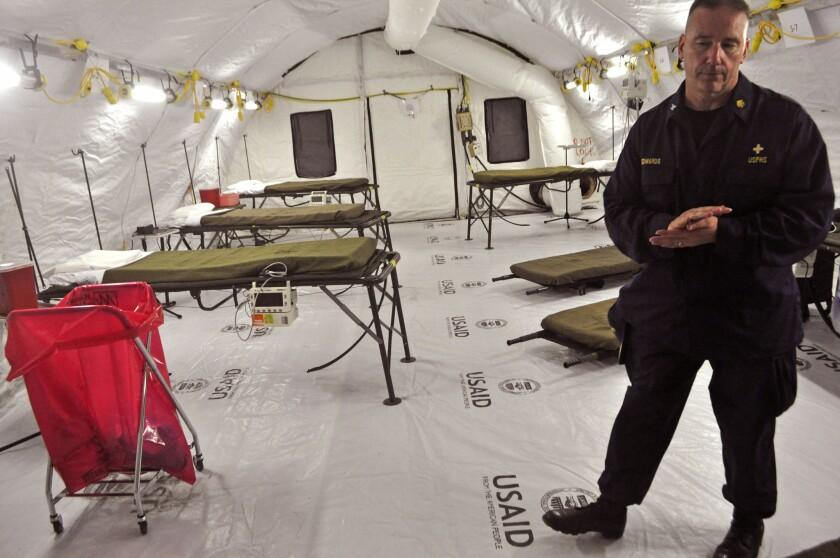 A health worker stands inside a medical tent that forms part of a new Ebola treatment unit built by the U.S. on the outskirts of the Liberian capital, Monrovia.