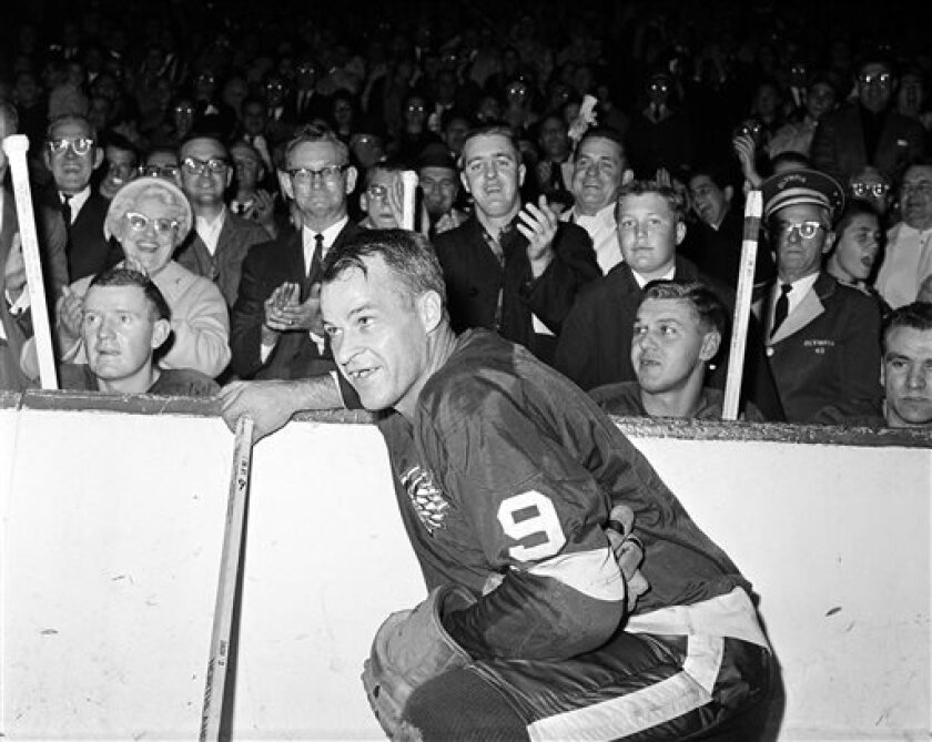 FILE- In this Nov. 10, 1963 file photo, the Detroit Red Wings' Gordie Howe (9)  acknowledges applause from the fans during a 20-minute standing ovation after he scored the 545th cgoal of his National Hockey League career at Detroit's Olympia Stadium, to set the leagues'  to set the all-time scoring