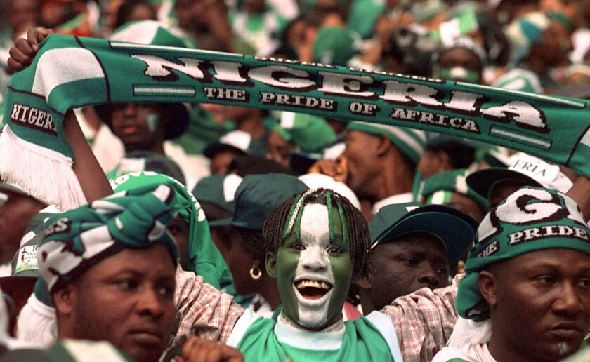 Nigerian soccer fans wait for the start of the soccer World Cup 98 second round match between Nigeria and Denmark at the Stade de France in Saint Denis, north of Paris Sunday, June 28, 1998. The winner of the game will play against Brazil in the quarterfinals in Nantes on July 3.
