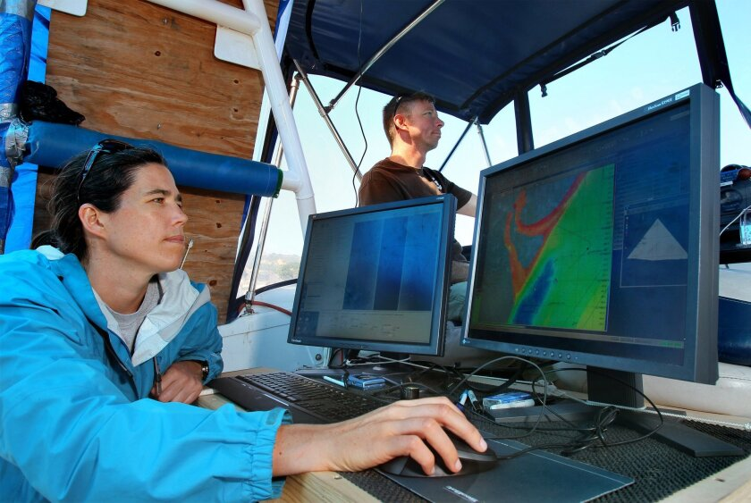 Jillian Maloney, a graduate student at the Scripps Institution of Oceanography in La Jolla, uses sonar to map the bottom of San Diego Bay near its outlet at Point Loma.