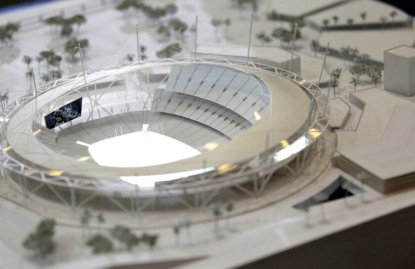 A scale model produced by architect Dan Meis shows a possible new Chargers stadium in Mission Valley. Photo by John Gastaldo/U-T San Diego/Zuma Press