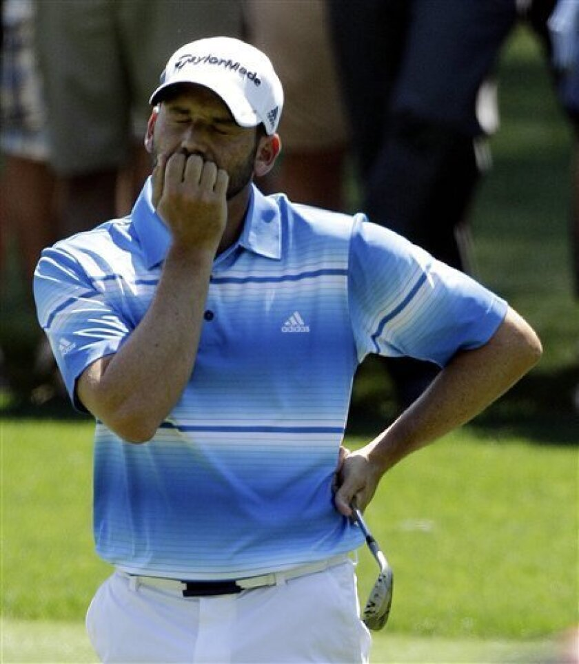 Sergio Garcia, of Spain, reacts after second shot on the third hole during the third round of the Masters golf tournament Saturday, April 7, 2012, in Augusta, Ga. (AP Photo/Matt Slocum)