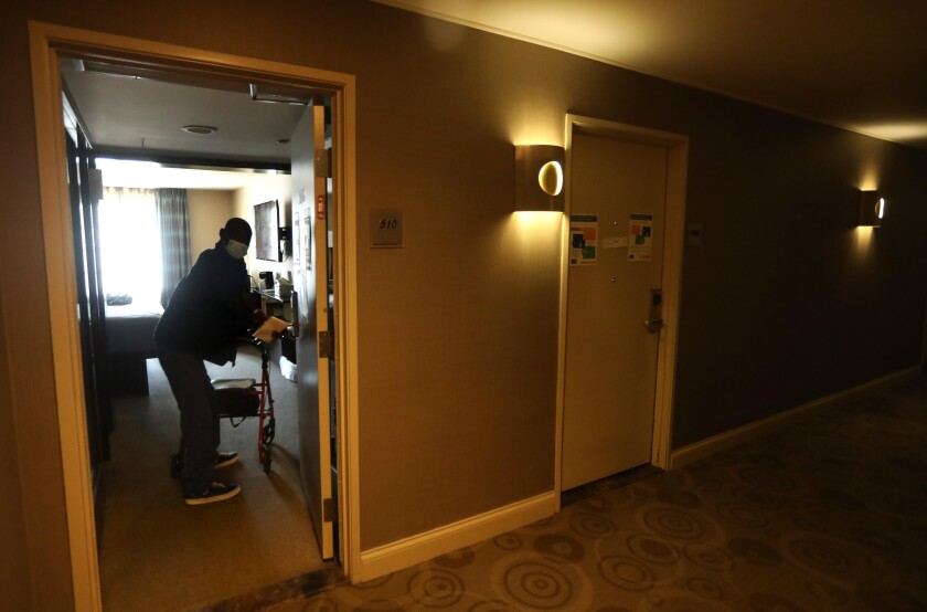 David William, 63, returns to his room at a Project Roomkey hotel.