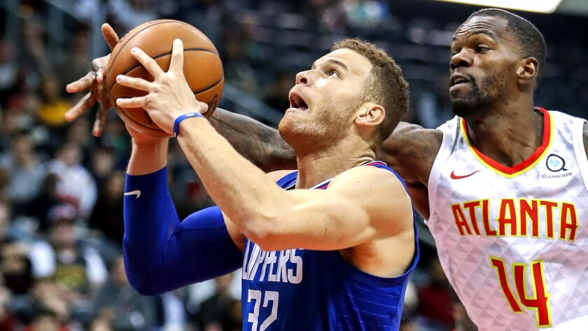 Clippers forward Blake Griffin tries to power his way past Hawks center Dewayne Dedmon during the first half Wednesday.