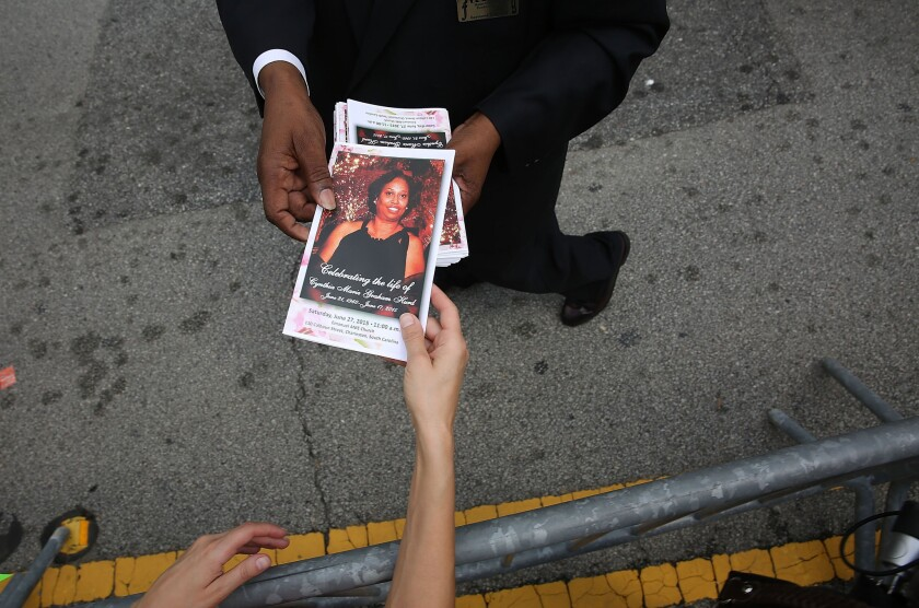 A program is handed out before the funeral of Cynthia Hurd, 54, at the Emanuel African Methodist Episcopal Church on June 27, 2015.