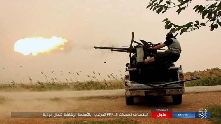 An image posted online May 1 purports to show an Islamic State fighter firing on Syrian Democratic Forces in the northern province of Raqqa.
