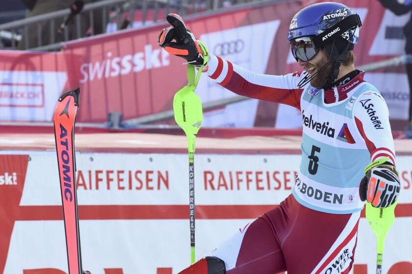 Austria's Marco Schwarz celebrates winning an alpine ski, men's World Cup slalom, in Adelboden, Switzerland, Sunday, Jan.10, 2021. (AP Photo/Marco Tacca)