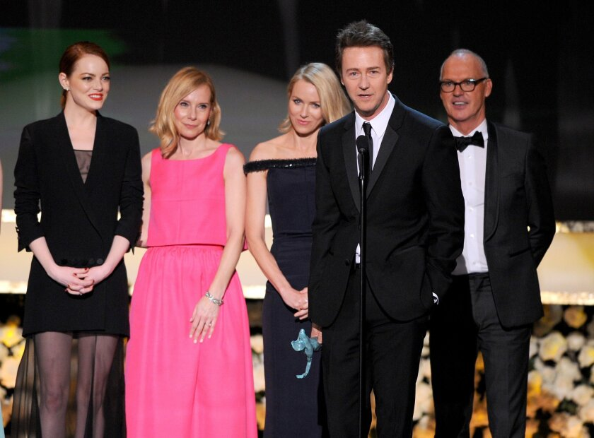 """Emma Stone, left, Amy Ryan, Naomi Watts, Edward Norton, and Michael Keaton accept the award for outstanding performance by a cast in a motion picture for """"Birdman"""" onstage at the 21st Screen Actors Guild Awards at the Shrine Auditorium on Sunday in Los Angeles."""