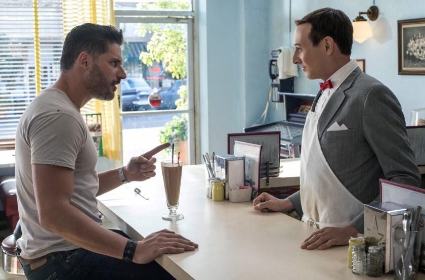 "Pee-wee Herman (Paul Reubens, rightmeets his new best friend, Joe Manganiello (as himself), in a scene from the new Netflix movie ""Pee-wee's Big Holiday."""