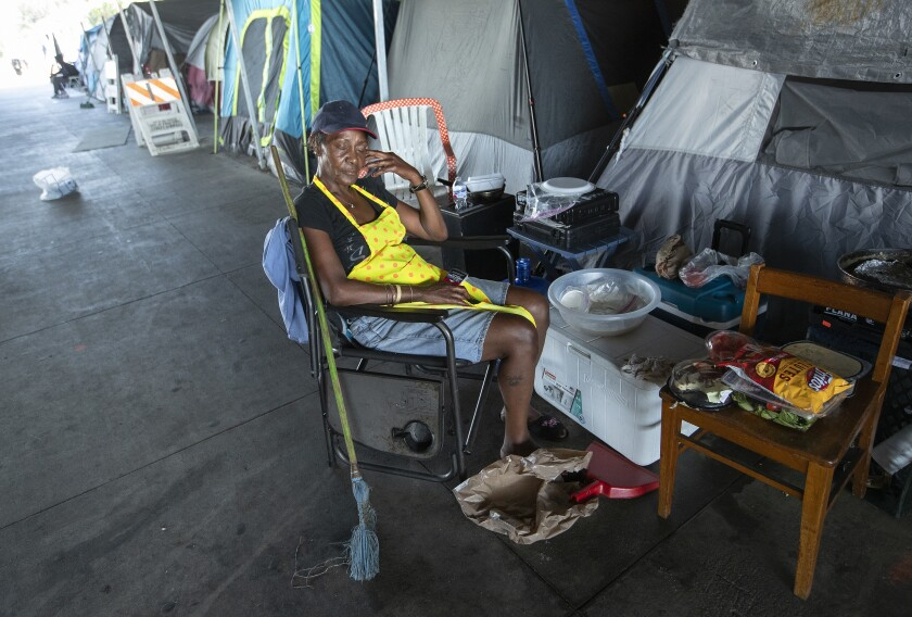 Catherine Hoskins, 58, gets some sleep at the homeless encampment in Pacoima.