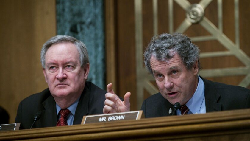 Senate Banking Committee Chairman Mike Crapo (R-Idaho), left, the lead sponsor of a bank deregulation bill, and Sherrod Brown (D-Ohio), who is leading opposition to the legislation, participate in a hearing on Jan. 30.