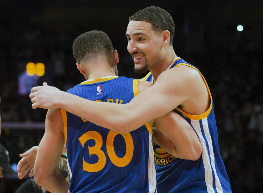 Golden State Warriors guard Klay Thompson (11) hugs Golden State Warriors guard Stephen Curry (30) after winning the three point competition at the NBA all-star weekend in Toronto on Saturday, Feb. 13, 2016. (Mark Blinch/The Canadian Press via AP) MANDATORY CREDIT