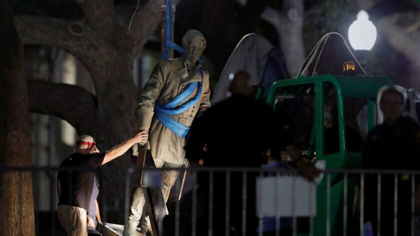 A statue of Confederate Gen. Robert E. Lee is removed from the University of Texas campus, early Monday morning in Austin, Texas.