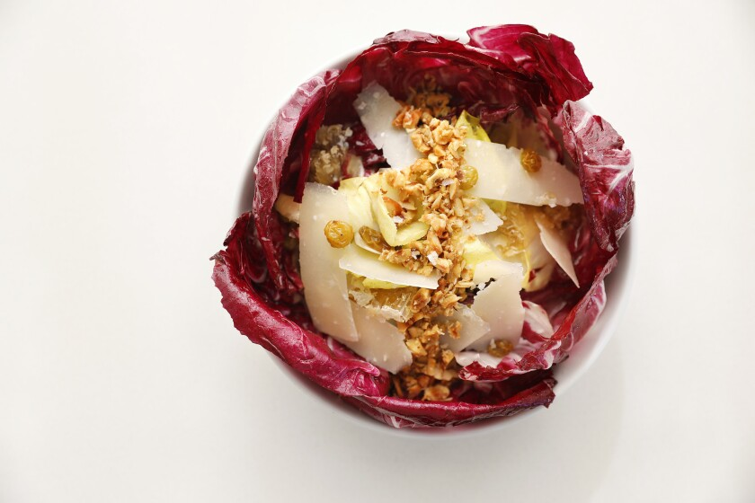 The roasted radicchio at Dominique Ansel's new restaurant 189 at the Grove comes with fresh honeycomb, endive, hazelnuts, shaved manchego and lemon hazelnut vinaigrette.