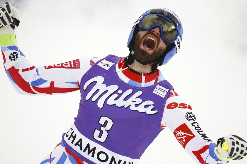 France's Thomas Mermillod Blondin celebrates his third place after completing the downhill portion of an alpine ski, men's World Cup combined race, in Chamonix, France, Friday, Feb. 19, 2016. (AP Photo/Giovanni Auletta)