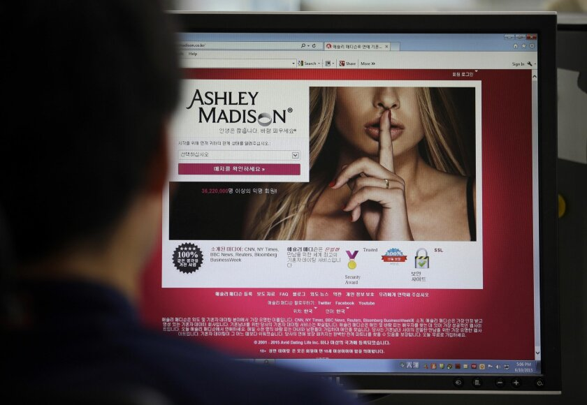FILE - In this June 10, 2015 photo, Ashley Madison's Korean web site is shown on a computer screen in Seoul, South Korea. Avid Life Media Inc., the parent company of Ashley Madison, a matchmaking website for cheating spouses, said it was hacked and that the personal information of some of its users