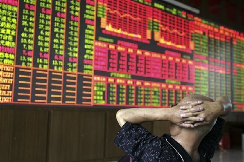 A stock investor checks the stock index at a brokerage house in Taiyuan, in north China's Shanxi province, Wednesday, June 30, 2010. Chinese shares fell for a sixth day Wednesday amid weak investor confidence following Wall Street's overnight decline. (AP Photo)