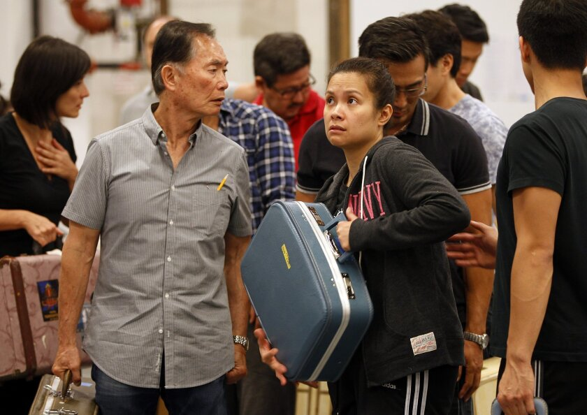 "George Takei and Lea Salonga rehearse a scene from the Old Globe's ""Allegiance."""