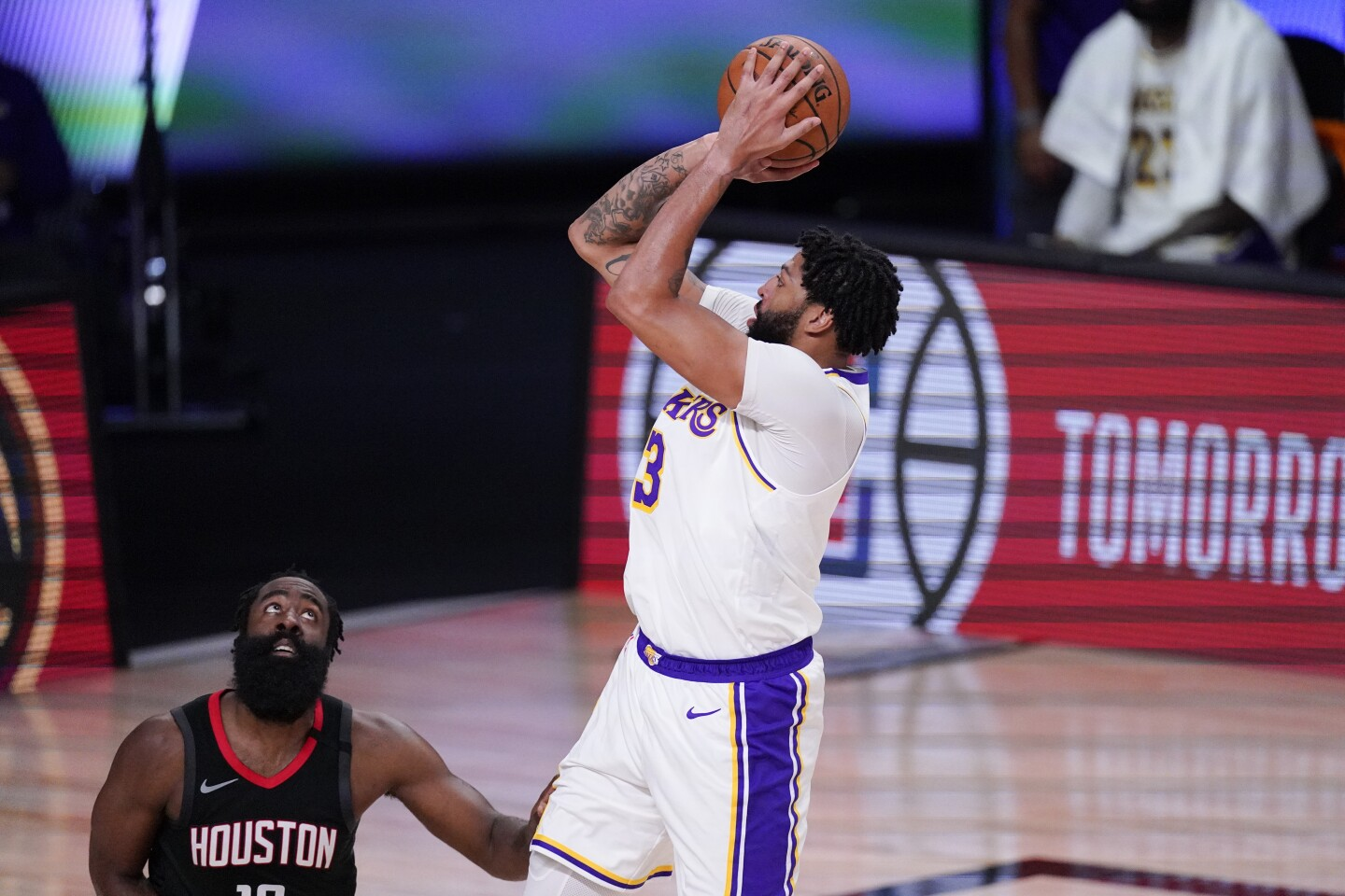 The Lakers' Anthony Davis shoots over the Rockets' James Harden in the first half of Game 5 on Saturday near Orlando, Fla.