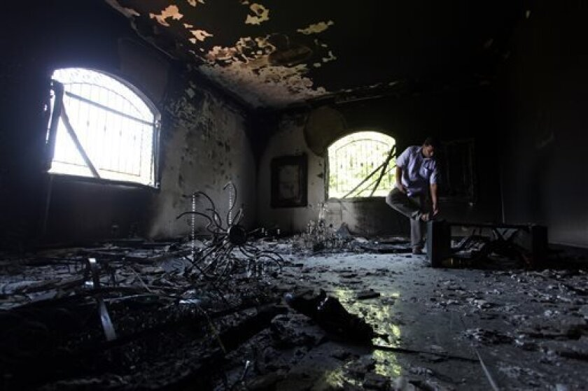 FILE - In this Thursday, Sept. 13, 2012 file photo, a Libyan man investigates the inside of the U.S. Consulate after an attack that killed four Americans, including Ambassador Chris Stevens, on the night of Tuesday, Sept. 11, 2012, in Benghazi, Libya. House Republicans insist the Obama administrati