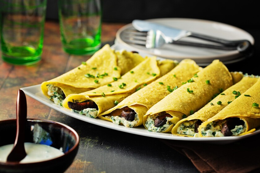 Garbanzo bean crepes are filled with grilled portobello mushrooms, spinach and ricotta.