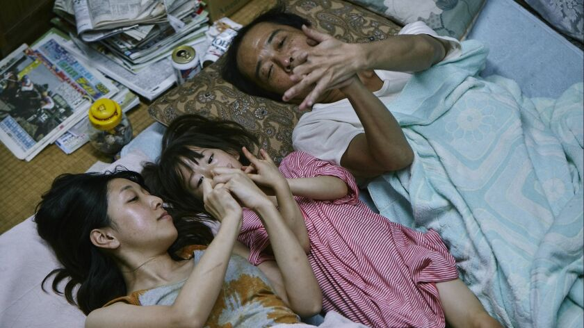 """(L-R) - Ando Sakura, Sasaki Miyu and Lily Franky in """"SHOPLIFTERS,"""" a Magnolia Pictures release. Cred"""