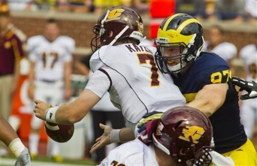 Michigan linebacker Brennen Beyer (97) causes Central Michigan quarterback Cody Kater (7) to fumble the ball in the first quarter of an NCAA college football game, Saturday, Aug. 31, 2013, in Ann Arbor, Mich. (AP Photo/Tony Ding)