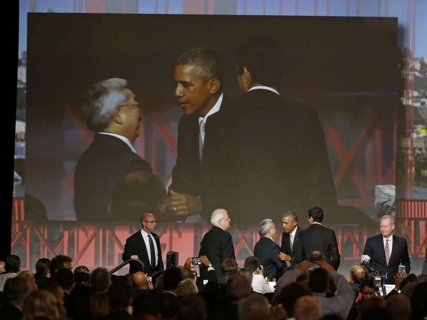 President Obama is greeted by San Francisco Mayor Ed Lee after making an address to the U.S. Conference of Mayors on Friday.