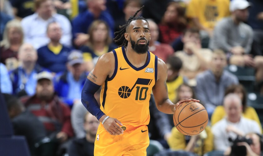 Jazz guard Mike Conley brings the ball upcourt against the Pacers during a game Nov. 27, 2019, in Indianapolis.