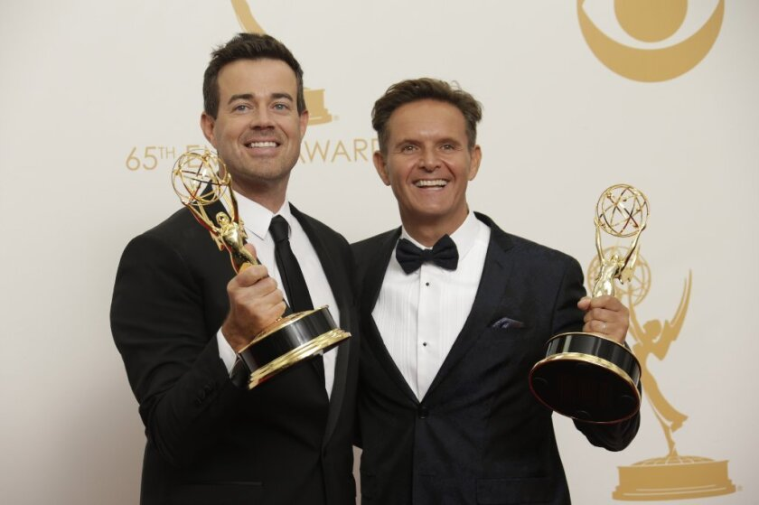"Producer Carson Daly, from left, and executive producer Mark Burnett of ""The Voice"" celebrate winning reality - competition program in the press room at the 65th Annual Primetime Emmy Awards."