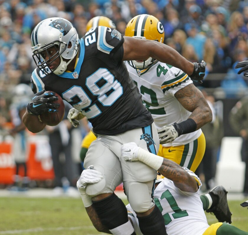 Carolina Panthers' Jonathan Stewart (28) runs as Green Bay Packers' Ha Ha Clinton-Dix (21) tries to tackle in the first half of an NFL football game in Charlotte, N.C., Sunday, Nov. 8, 2015. (AP Photo/Bob Leverone)