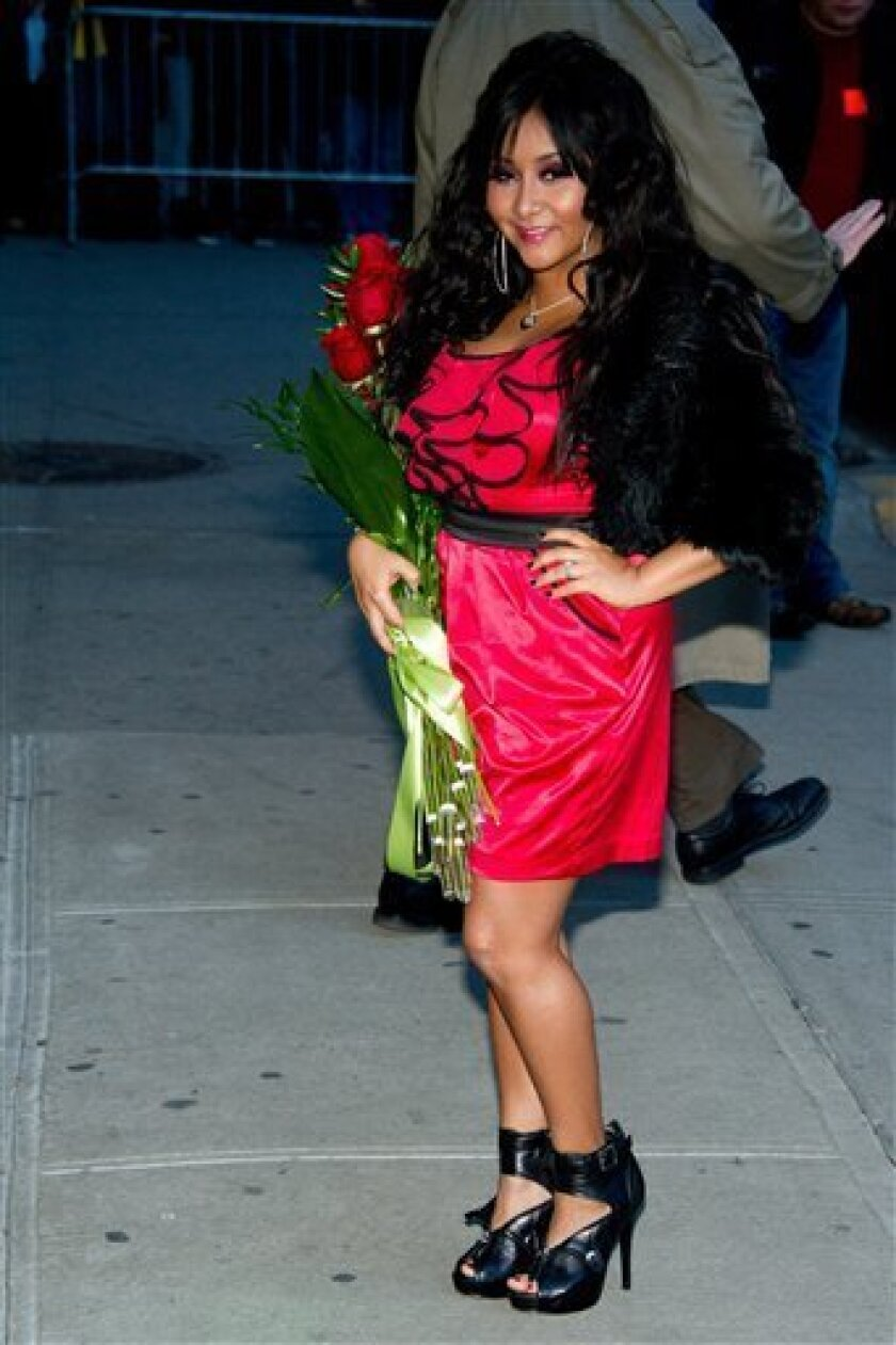 """FILE - Nicole 'Snooki' Polizzi leaves a taping of the """"Late Show with David Letterman"""" in New York, in this Jan. 10, 2011 file photo. The Rutgers University Programming Association paid Nicole """"Snooki"""" Polizzi of the reality TV show """"Jersey Shore"""" $32,000 Thursday March 31, 2011 to dish on her hairstyle, fist pumps, as well as the GTL _ gym, tanning, laundry_ lifestyle. That's $2,000 more than the $30,000 the university is paying Nobel-winning novelist Toni Morrison to deliver Rutgers' commencement address in May. (AP Photo/Charles Sykes, File)"""