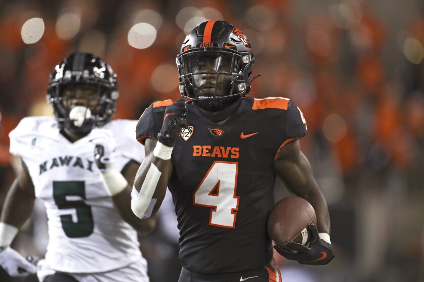 Oregon State running back B.J. Baylor (4) rushes 66 yards for a touchdown during the first half of an NCAA football game against Hawaii on Saturday, Sept. 11, 2021, in Corvallis, Ore. (AP Photo/Amanda Loman)
