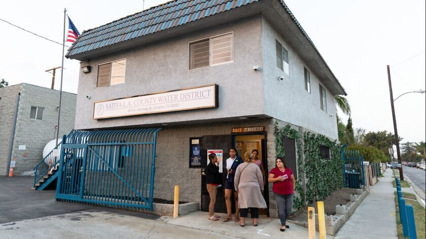 Residents gather outside the Sativa Los Angeles County Water District office during a June meeting.