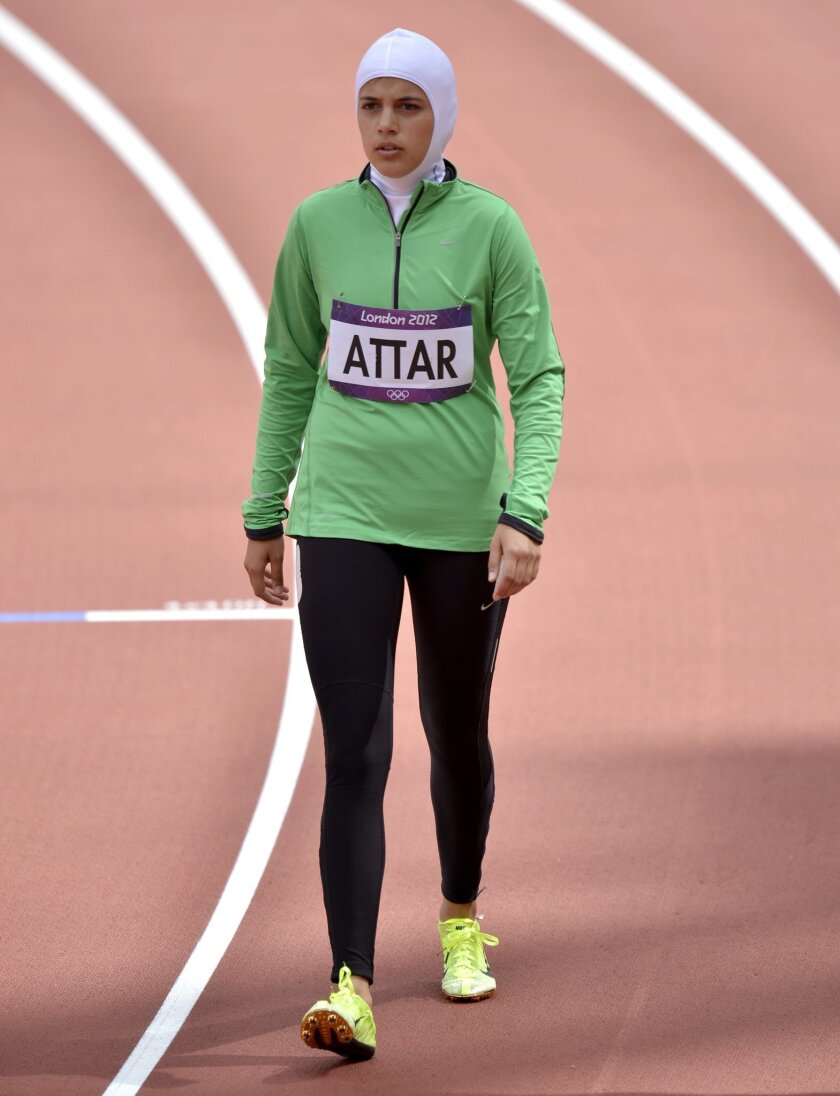 FILE -- In this Aug. 8, 2012 file photo, Saudi Arabia's Sarah Attar prepares to compete in a women's 800-meter heat during the athletics in the Olympic Stadium at the 2012 Summer Olympics, London. Saudi Arabia will send four women to the Rio de Janeiro Olympics, doubling its female participation af