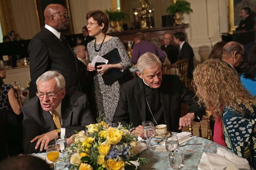 Catholic Archbishop of Washington Donald Wuerl joins other Christian leaders during an Easter prayer breakfast at the White House last month. Although such public expressions of religion remain a feature of American life, the nation's Christian population has declined, a new study shows.