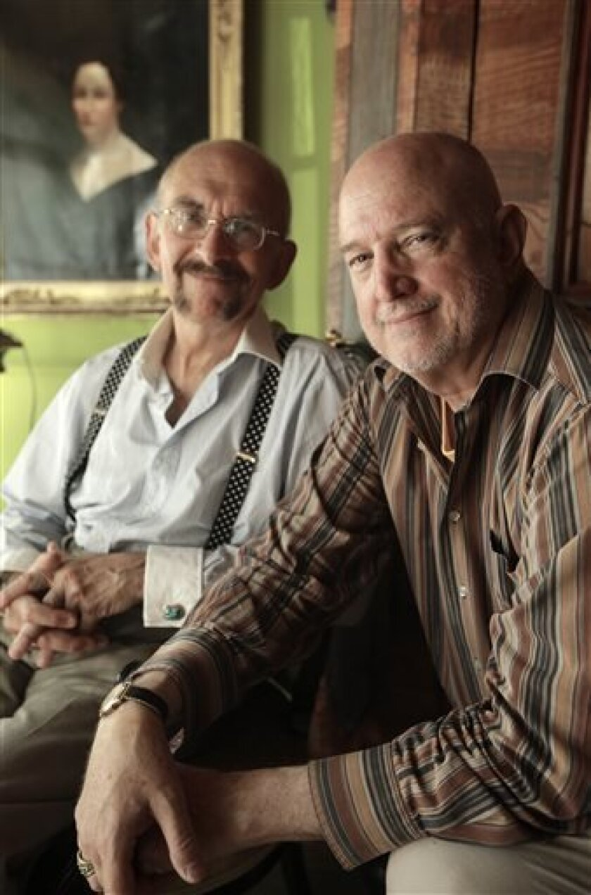 In this Monday, July 29, 2013, photo John Gacher, 61, left, and Federico Santi, 66, both of Newport , R.I., sit together in their home in Newport. The rest of New England already allows same-sex marriage with Rhode Island as a holdout, but that is to change Thursday, Aug. 1, 2013 when it becomes legal in the state. The couple plans to turn their civil union into a marriage Thursday morning at Newport City Hall. (AP Photo/Steven Senne)