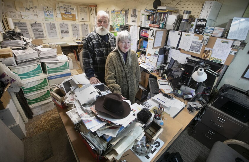 Michael Hart and his wife Michele Harvey have run the Julian News in Julian, CA for almost 17 years. They were photographed in their tiny, cluttered offices on March 11, 2020.