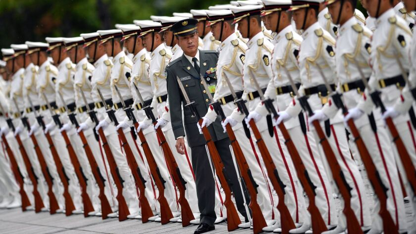 A Japanese Self-Defense Force officer inspects the honor guard last month before the arrival of Prime Minister Shinzo Abe at the Defense Ministry in Tokyo.