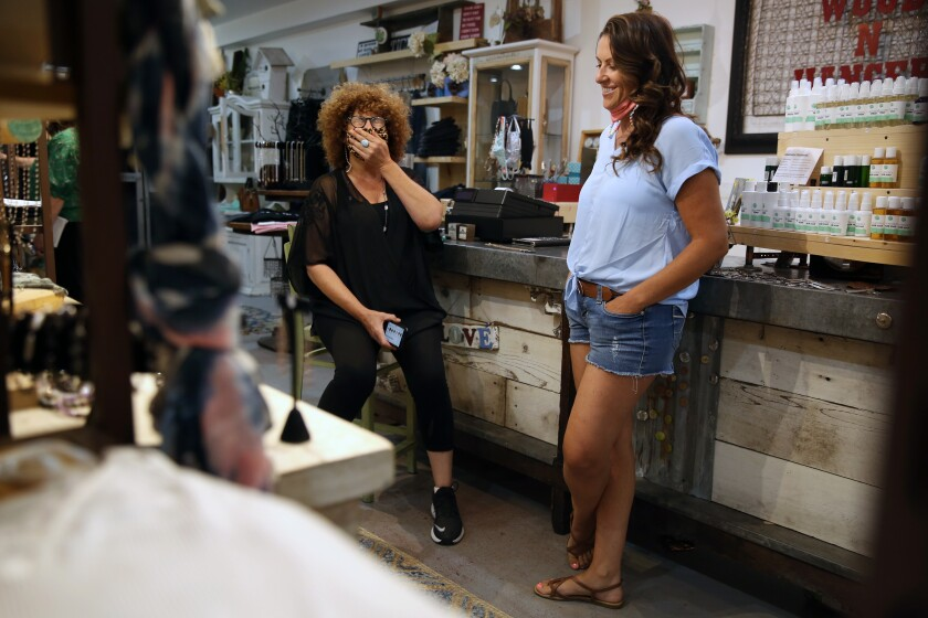 Sami Bennett, left, speaks with Kimberly Holman-Maiden at Wood 'N' Hanger in Woodland Hills.