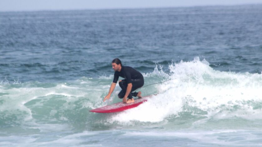 SIO post-doctoral student Nick Pizzo cathing waves at a surf session July 18 near Scripps Pier.