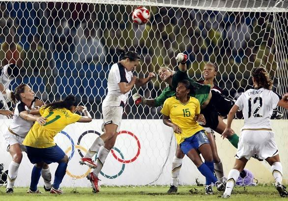 U.S. midfielder Shannon Boxx heads away a corner kick as Brazil threatens to score late in the second half of overtime at the women's Olympic soccer final.