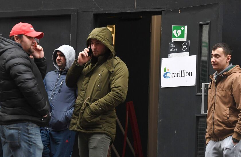 Carillion workers line up outside a sits office to check on the status of their jobs in London, Britain, 15 January 2018. Thousands of jobs in the UK and abroad may be lost following the news that Construction company Carillion is to go into liquidation.