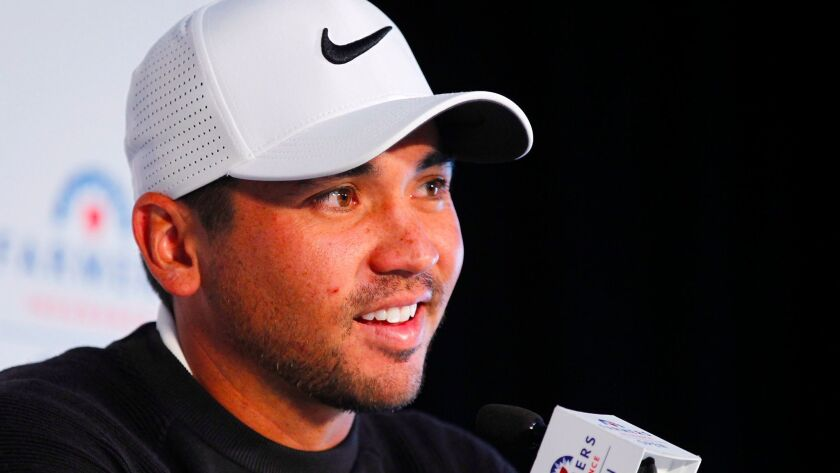 Golfer Jason Day speaks at a news conference for the Farmers Insurance Open.