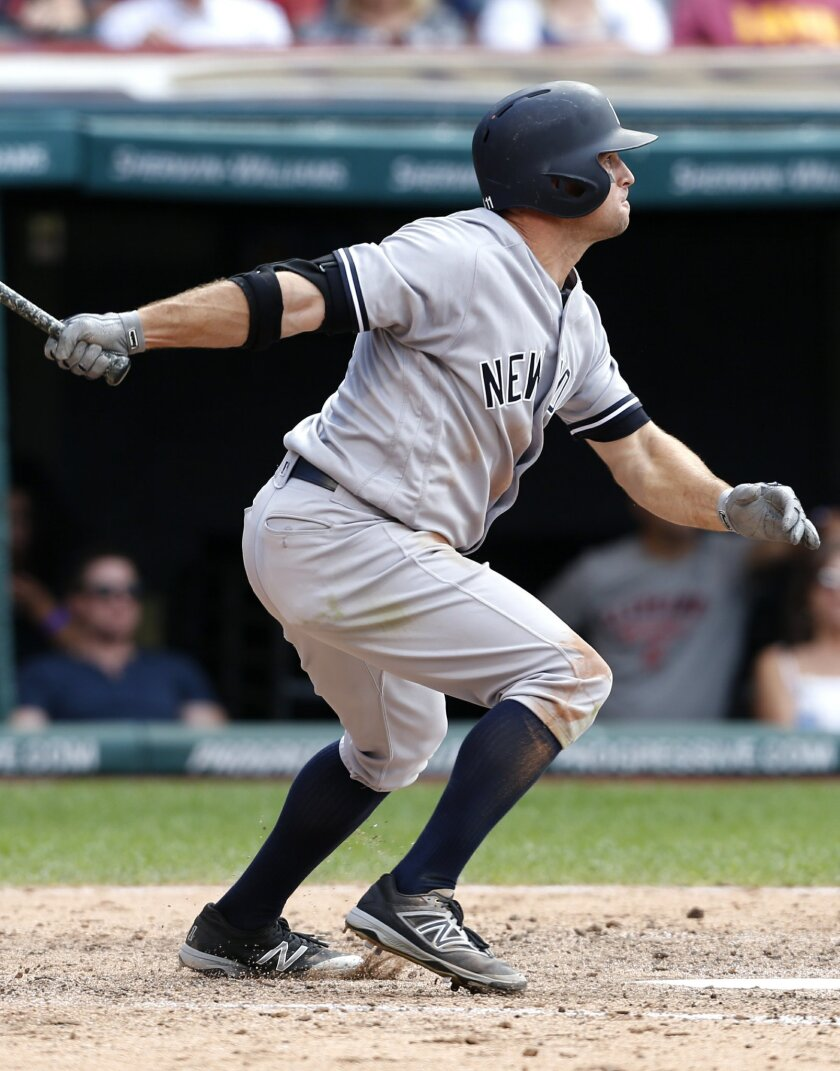 New York Yankees' Brett Gardner hits a three-run triple off Cleveland Indians relief pitcher Dan Otero during the sixth inning of a baseball game Saturday, July 9, 2016, in Cleveland. (AP Photo/Ron Schwane)