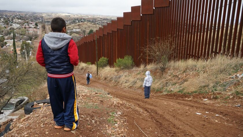 The 15-foot steel fence between portions of Nogales, Ariz., and Nogales, Mexico.