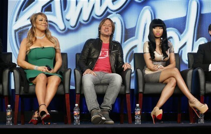 """In this Jan. 8, 2013 photo, from left, Mariah Carey, Keith Urban and Nicki Minaj from """"American Idol"""" attend the Fox Winter TCA Tour at the Langham Huntington Hotel, in Pasadena, Calif. """"American Idol"""" returns Wednesday, Jan. 16, 2013, for season 12. (Photo by Todd Williamson/Invision/AP)"""