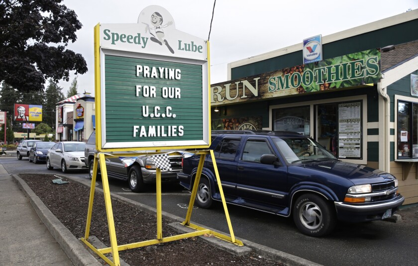 A message of healing is displayed at a local business after a fatal shooting at Umpqua Community College in Roseburg, Ore.