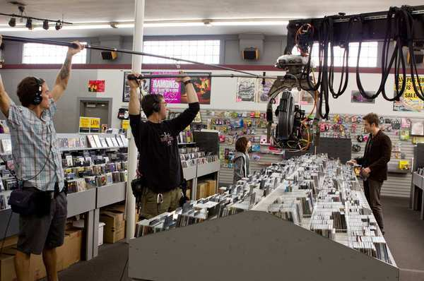 """Chris Pine, right, and Michael D'Addario in a scene from """"People Like Us"""" at Rhino Records in Claremont."""