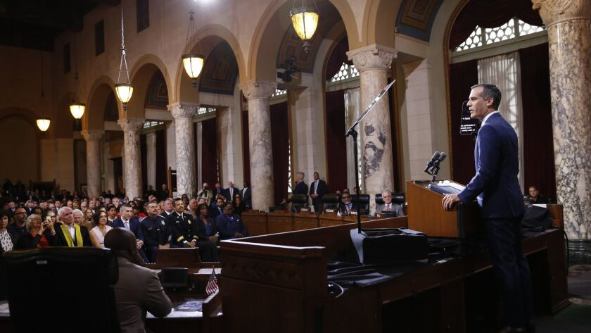 Mayor Eric Garcetti delivers his State of the City address in Los Angeles City Hall council chambers. Los Angeles is sending back $425,000 in federal money to the Department of Homeland Security after lawmakers stalled on whether to take the funding.